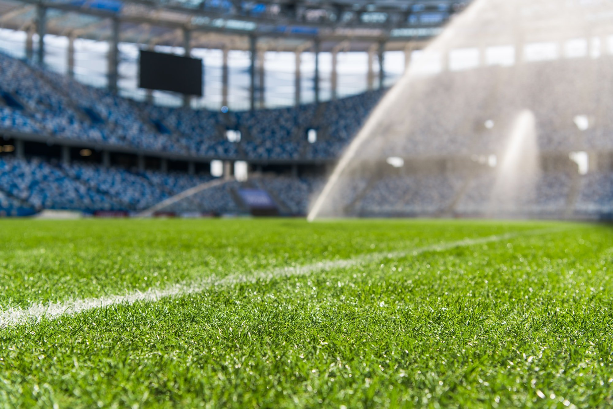 Dew on the artificial grass at empty stadium.